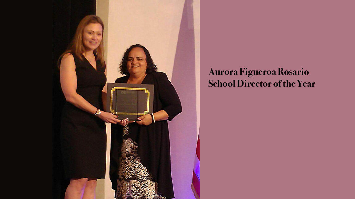 Aurora Figueroa receiving award